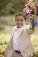 Portrait of boy with flowers