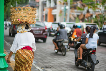 Balinese woman on a street of Ubud
