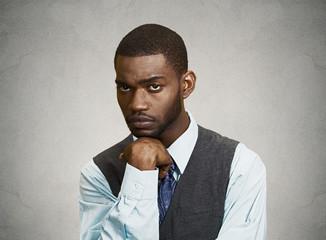Portrait Sad, depressed man isolated grey wall background