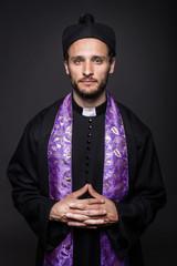 Humble catholic priest