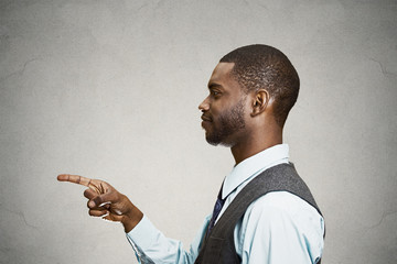 Side view portrait business Man pointing finger at someone