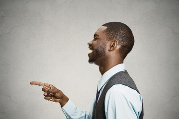 Portrait side view Man pointing finger laughing at someone