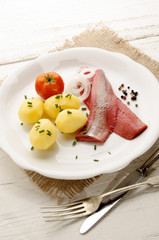 pink herring with potato and onion