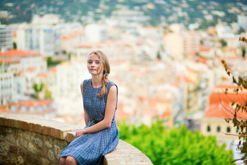 Elegant young woman in the Old town of Cannes
