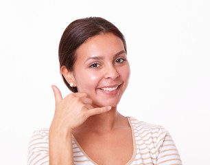 Pretty cheerful woman with call gesture