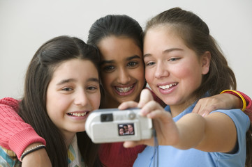Three girls taking picture of themselves