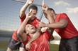 Teammates gesturing number one
