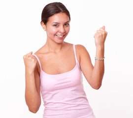 Cheerful latin girl with winning gesture
