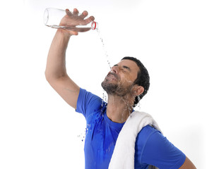 attractive athletic sport man exhausted pouring water on  face