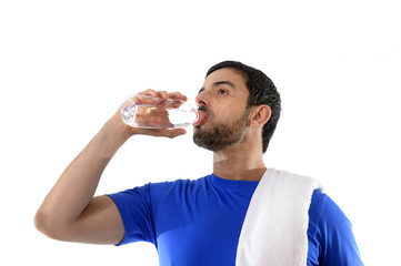 young attractive and athletic sport man drinking water