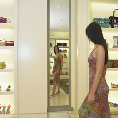 Young woman admiring shoes in a mirror