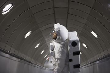Astronaut using an escalator