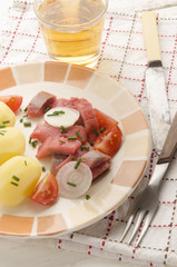 sliced pink ​​herring fillet with potato