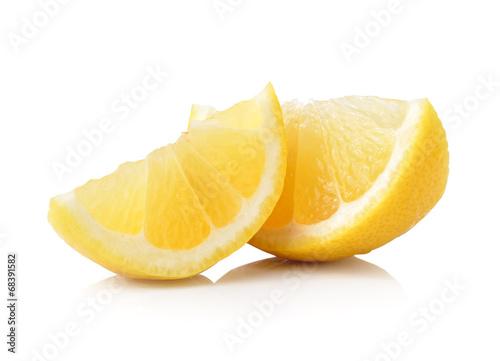 Fotobehang Vruchten Slice of lemon fruit isolated on white background