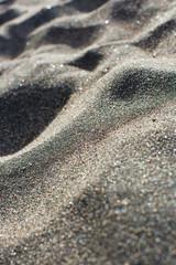 Closeup of black volcanic sand on a beach