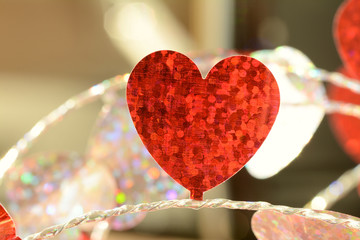 Red flat foil heart on string Close up