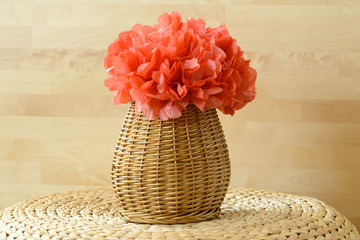 Woven vase basket with red paper flower pom pom