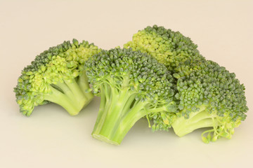 Fresh raw Broccoli on creamy background