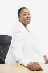 African businesswoman at her desk