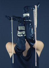 Woman wearing gloves and pearls