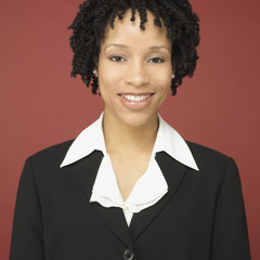 Studio shot of African businesswoman smiling