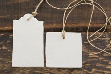 Blank tag,  rectangular and square, on wooden background