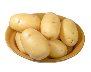 White potatoes fresh picked in bowl isolated