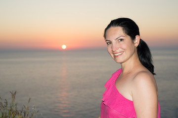 Beauty woman in front of sea sunset