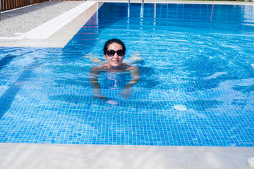 Woman swimming in the pool