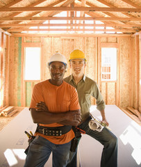 Two construction workers inside construction site