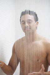 Man with eyes closed in shower