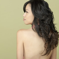 Studio shot of Asian woman with bare back