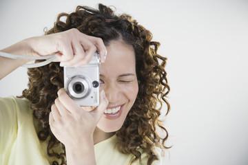 Asian woman using digital camera