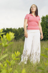 Young woman standing in meadow