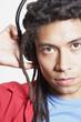 Close up of Hispanic man wearing headphones