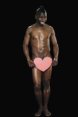 Nude African man with heart in front of genital area