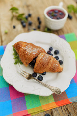 Breakfast - croissant with blueberries