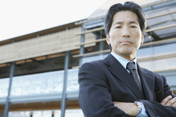 Portrait of Asian businessman with arms crossed