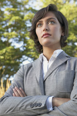 Portrait of Hispanic businesswoman with arms crossed