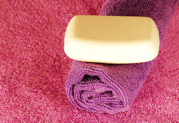 Soap bar on colorful towels