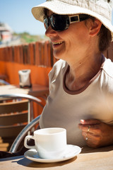 Happy woman with cup of coffee