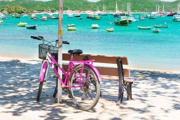 Bicycle parked on the seafront in Buzios. Brazil
