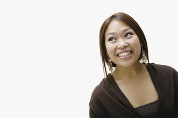 Studio shot of Asian woman smiling