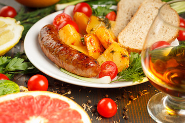 sausage with potatoes and vegetables