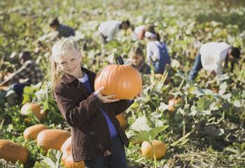 Girl smiling in pumpkin patch