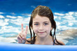 Closeup portrait of little girl in pool