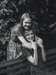portrait of  junior woman hugging adult sister at park