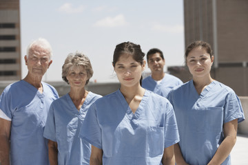 Group of doctors smiling in urban setting