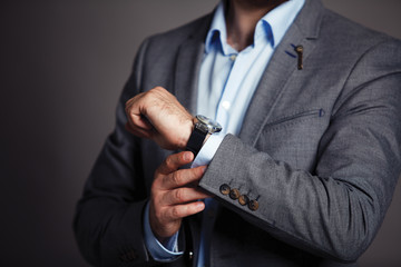 Businessman checking time on his wristwatch
