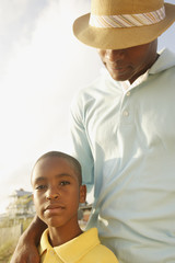 African father and son at beach